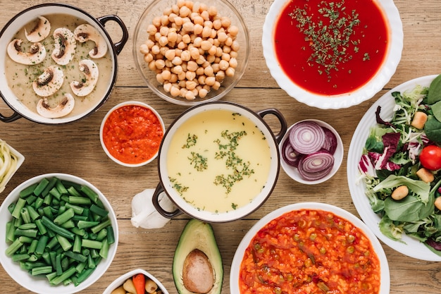 Top view of dishes with soups and green beans Free Photo