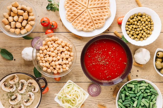 Top view of dishes with waffles and tomato soup Free Photo