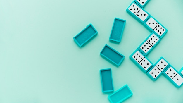 Top view dominos on blue background Free Photo
