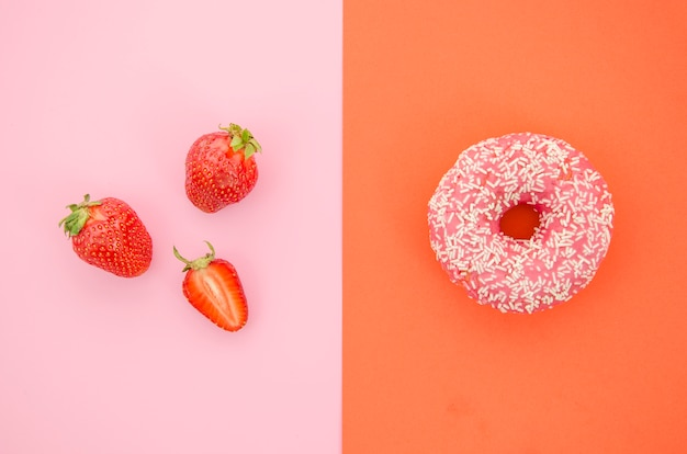 Top view donut vs fruit Premium Photo