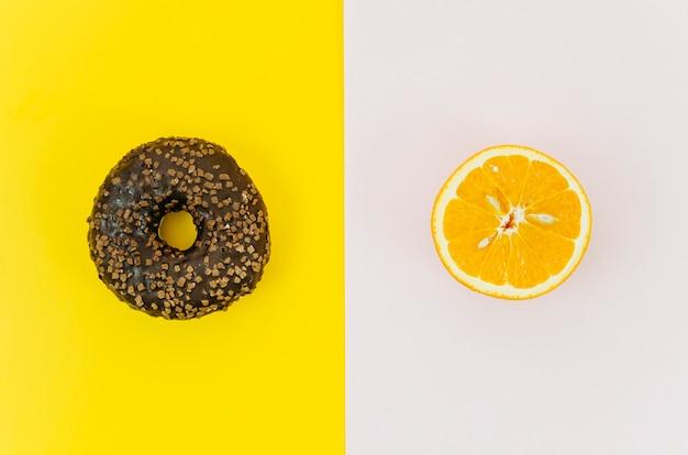 Top view donut vs fruit Free Photo