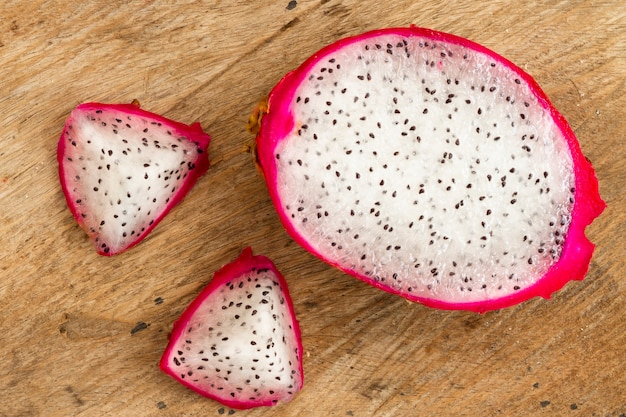 Top view dragon fruit with wooden background Free Photo