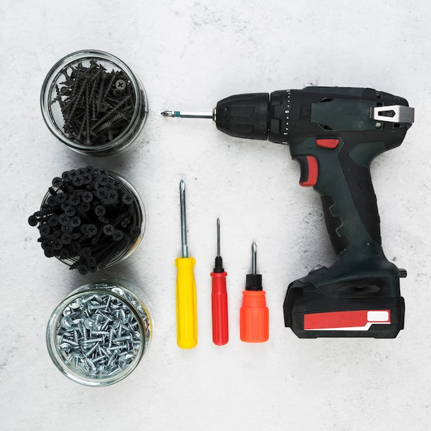 Top view drill with screws Premium Photo