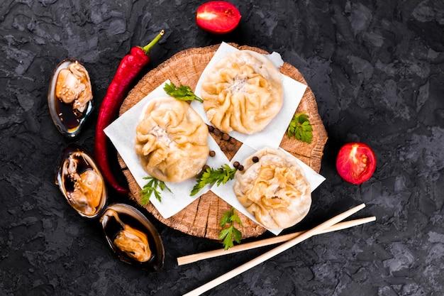 Top view  dumplings on wooden board Free Photo