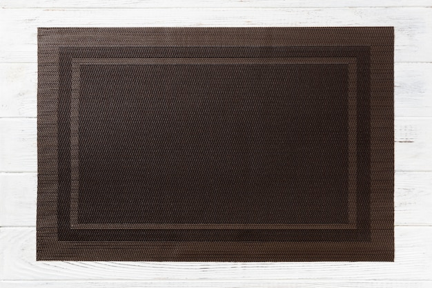 Top view of empty brown table napkin for dinner on wooden Premium Photo