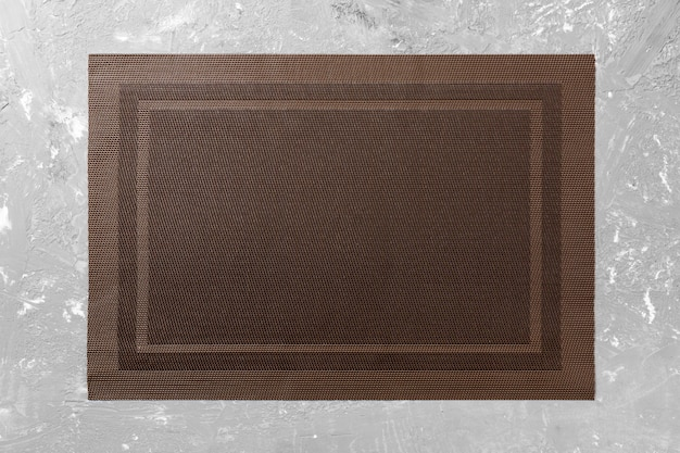 Top view of empty brown tablecloth on cement background with copy space Premium Photo