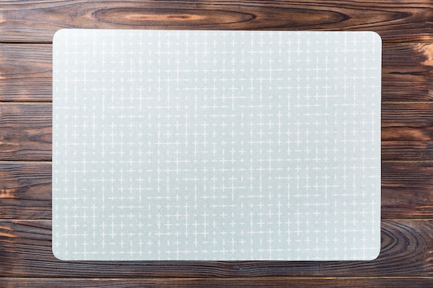 Top view of empty green table napkin for dinner on wooden Premium Photo
