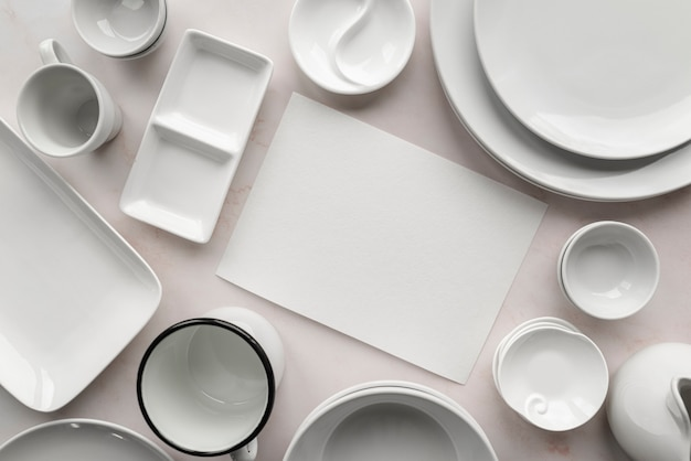 Top view of empty menu with white dishes Free Photo