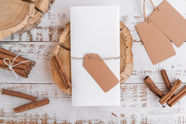 Top view of empty paper with tags and cinnamon sticks Free Photo