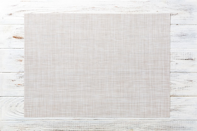Top view of empty white tablecloth on wooden table Premium Photo