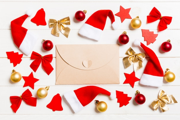 Top view of envelope on festive wooden background Premium Photo