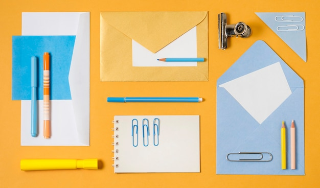 Top view envelopes and paperclips Free Photo