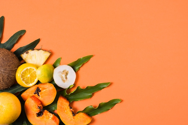 Top view exotic fruits on the table with copy space Free Photo