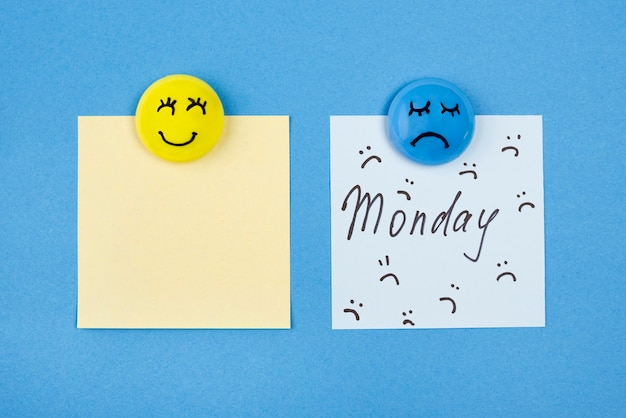 Top view of faces with emotions and sticky notes for blue monday Premium Photo
