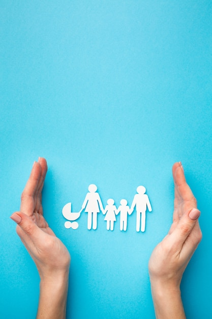 Top view family figure and hands with copy space Free Photo
