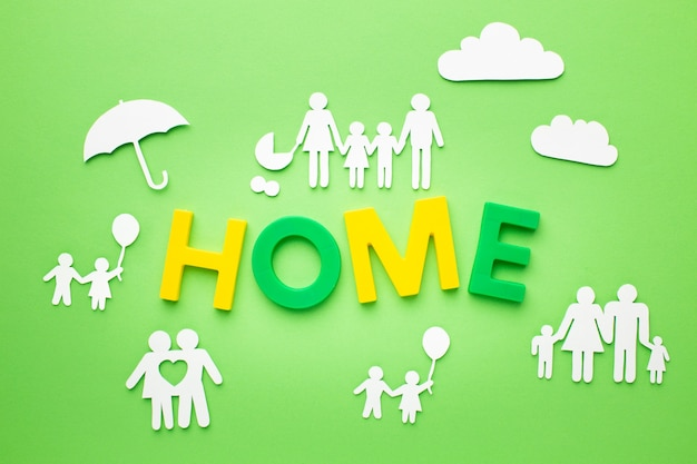 Top view family figures with home concept Free Photo