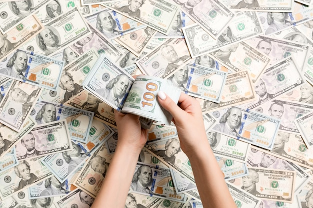 Top view of female hands counting money Premium Photo