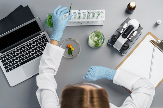 Top view of female researcher in the lab with laptop Premium Photo