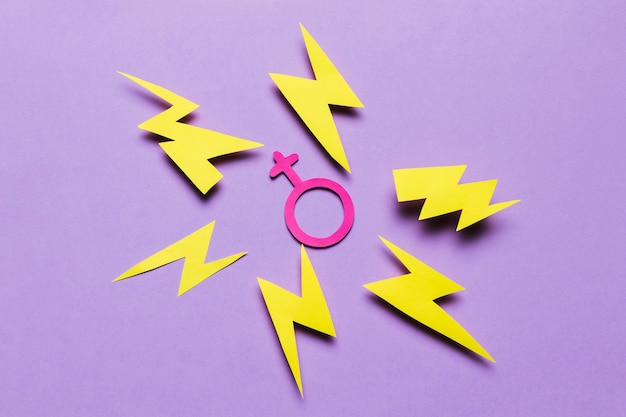 Top view feminine sign surrounded by thunders Free Photo