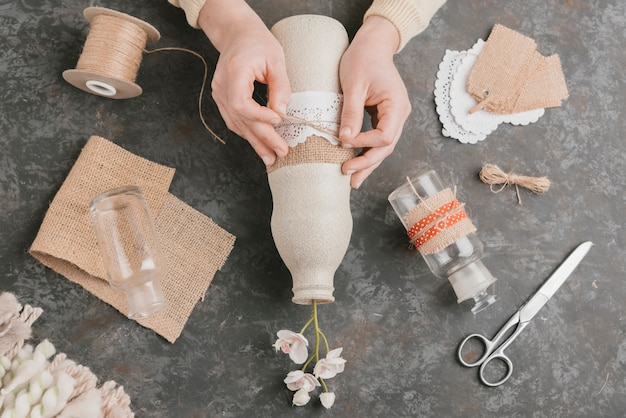 Top view final artistic touch vase creation Free Photo