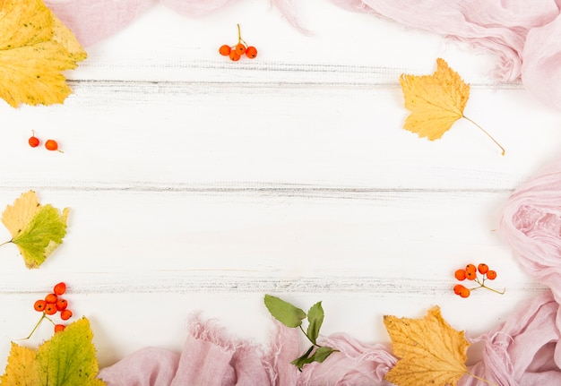 Top view firethorn and autumn leaves with copy space Free Photo