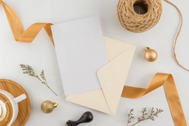 Top view, flat lay, wedding invitation card, envelopes, cards papers on white background. Premium Photo
