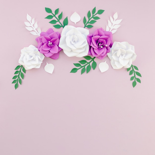 Top view floral frame with purple background Free Photo