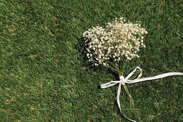 Top view flowers bouquet on grass Free Photo