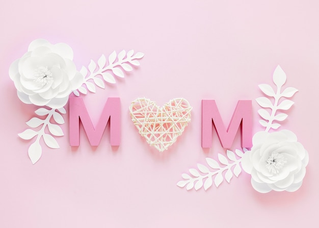 Top view flowers and m letters Free Photo