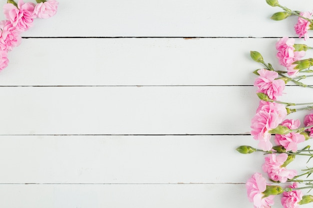 Top view flowers on wooden background with copy space Free Photo