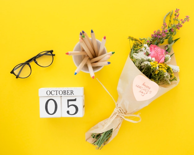 Top view flowers on yellow background Premium Photo