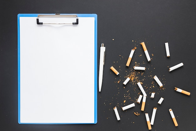 Top view folder with cigarettes Free Photo