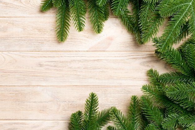 Top view of frame made of fir tree branches on wooden. Premium Photo