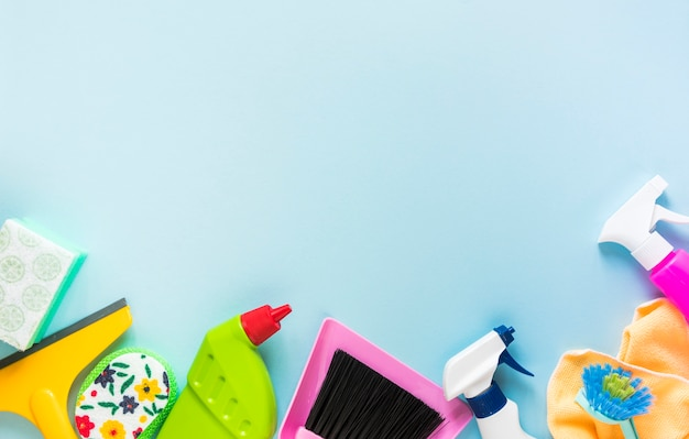 Top view frame with cleaning products and blue background Free Photo