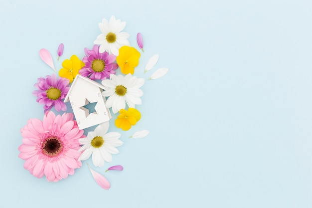 Top view frame with flowers and wooden house Free Photo