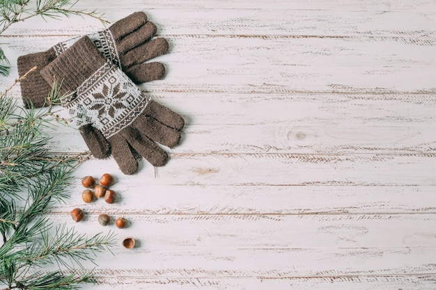 Top view frame with gloves on wooden background Free Photo