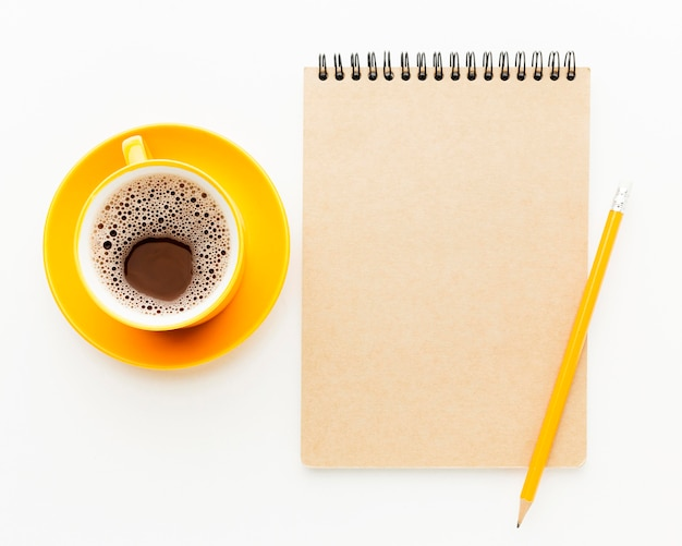 Top view frame with notebook and coffee Free Photo