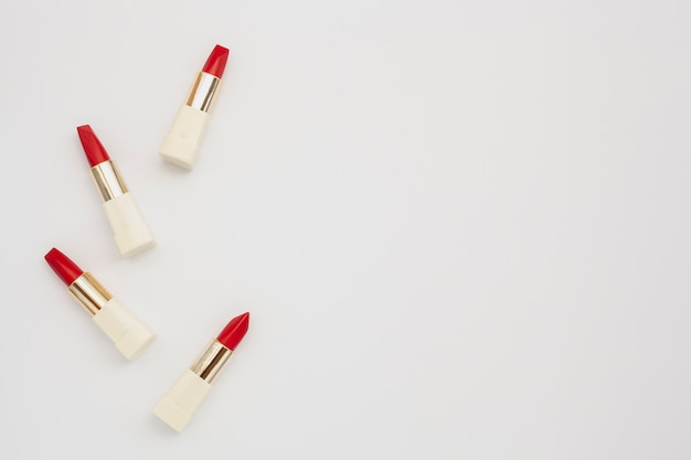 Top view frame with red lipstick and copy-space Free Photo