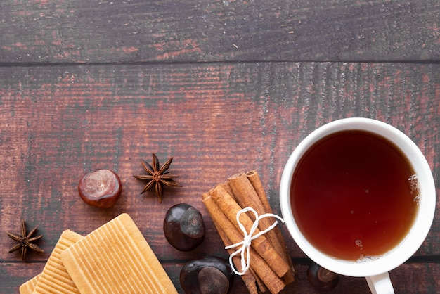 Top view frame with tea cup and wooden background Free Photo