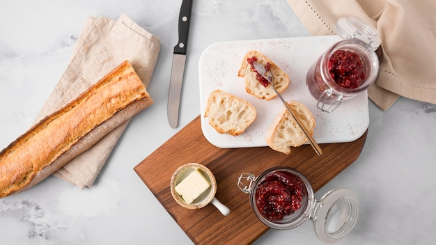Top view french baguette with wild berry jam Free Photo