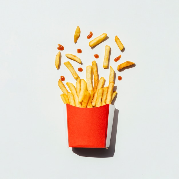 Top view french fries in a red box Free Photo