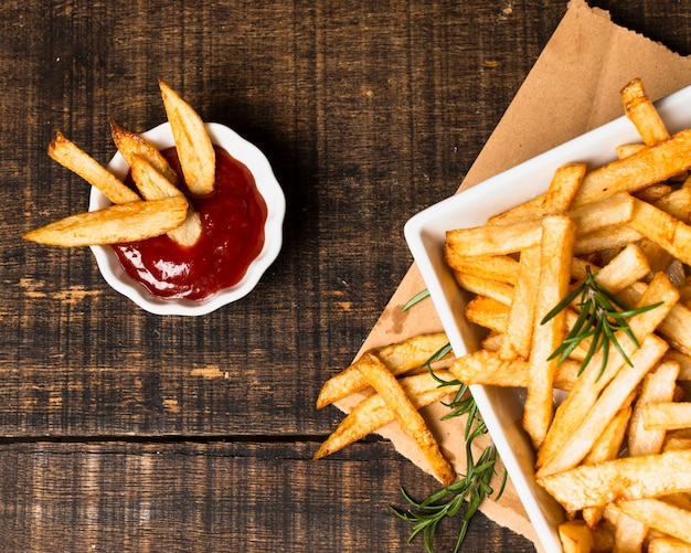 Top view of french fries with ketchup Free Photo