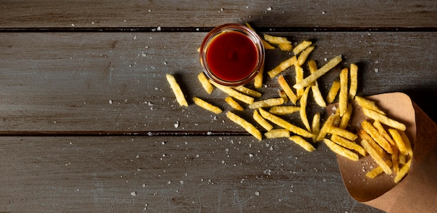 Top view frenchfries and ketchup with copy-space Premium Photo