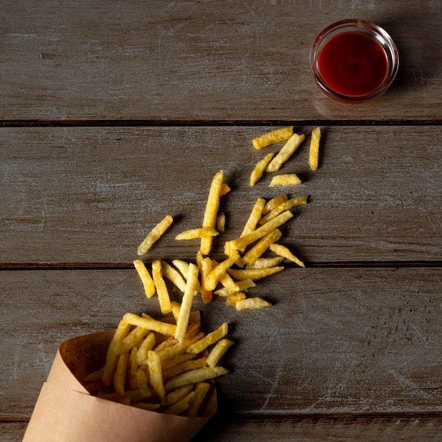 Top view frenchfries and ketchup Premium Photo