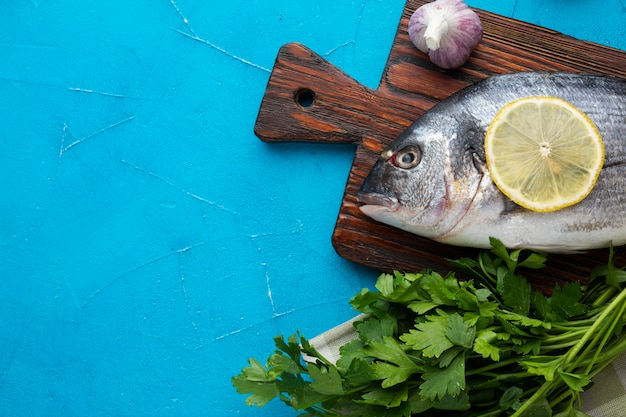 Top view fresh fish with lemon Free Photo