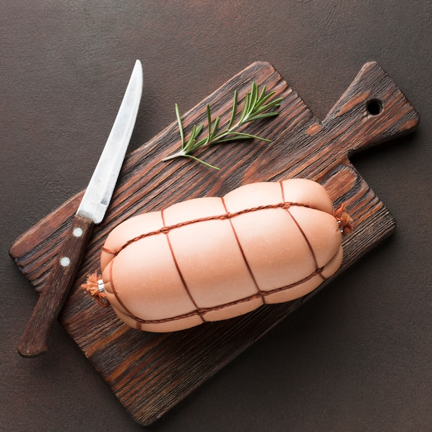 Top view fresh meat with knife and rosemary Free Photo