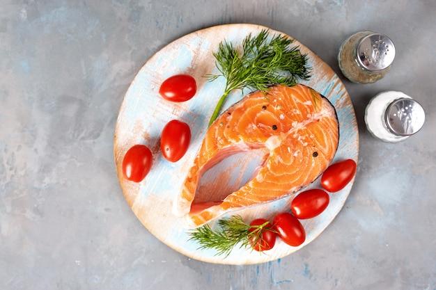 Top view of fresh salmon steak on light blue background Premium Photo