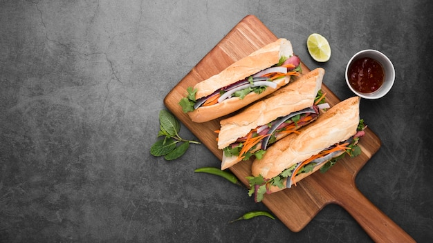 Top view of fresh sandwiches on chopping board Free Photo