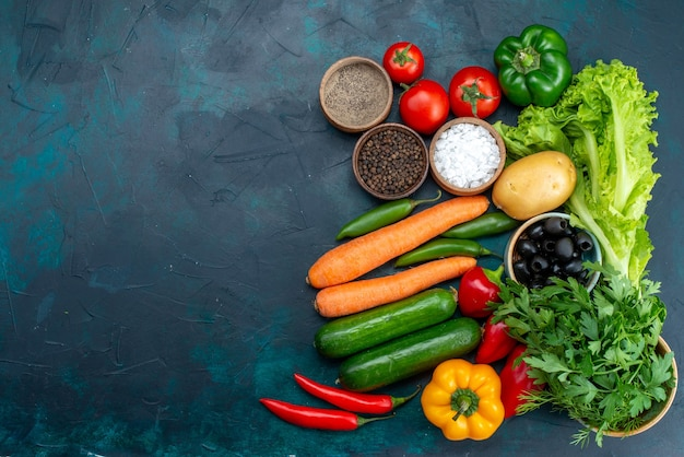 Top view fresh vegetables with greens on the dark-blue background salad snack vegetable food Free Photo