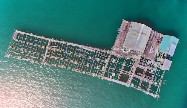 Top view from sky of floating sea house. Premium Photo